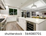 Stock photo gourmet kitchen features white shaker cabinets with marble countertops stone subway tile 564080701