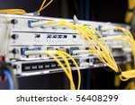 Network Switch with connected yellow cables - stock photo