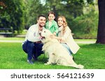 Stock photo family pet domestic animal and people concept happy family with labrador retriever dog on walk 564121639