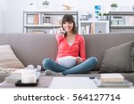 young smiling woman at home... | Shutterstock . vector #564127714