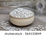 Small photo of Protein albumen source. Pile of Vegetable vegan vegetarian healthy nourishing nutritional meal white kidney haricot lima beans in wooden rural bowl on wooden rustic background. Phaseolus lunatus