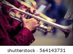 Small photo of trumpeter plays his trumpet in the brass band during live event