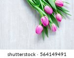 Pink Tulips Flowers  On Wooden...