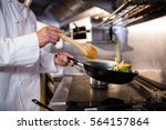 mid section of chef preparing... | Shutterstock . vector #564157864