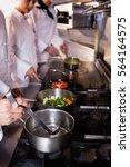 group of chef preparing food in ...   Shutterstock . vector #564164575