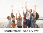 happy friends playing beach... | Shutterstock . vector #564177499