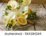 classic lemonade in glass jars  ... | Shutterstock . vector #564184264