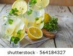 classic lemonade in glass jars  ... | Shutterstock . vector #564184327
