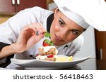 beautiful young chef decorating ...   Shutterstock . vector #56418463