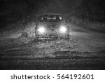 Small photo of A car driving on the road in the aggravated traffic due to strong snowfall.