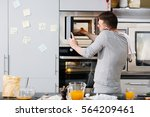 man in the kitchen | Shutterstock . vector #564209461