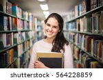 in the library   pretty female... | Shutterstock . vector #564228859