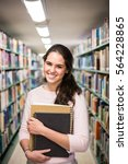 in the library   pretty female... | Shutterstock . vector #564228865