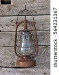 old kerosene lamp hanging on a... | Shutterstock . vector #564231367
