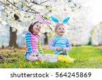 kids on easter egg hunt in... | Shutterstock . vector #564245869