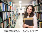 in the library   pretty female... | Shutterstock . vector #564247129