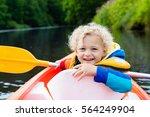 happy kid enjoying kayak ride... | Shutterstock . vector #564249904