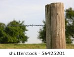 Wooden Posts With Barbed Wire