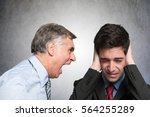 Angry Businessman Shouting To...