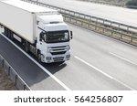 white truck on highway | Shutterstock . vector #564256807