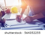 architect working on blueprint. ... | Shutterstock . vector #564352255