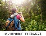 woman hiker watching through...   Shutterstock . vector #564362125