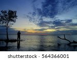 silhouette of photographer at... | Shutterstock . vector #564366001