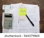 tax form with money  pen ... | Shutterstock . vector #564379864