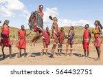 Small photo of MASAI MARA NATIONAL PARK, KENYA - DEC 27, 2016: dancing, jumping and singing masai men