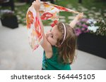 girl dancing with colorful scarf | Shutterstock . vector #564445105