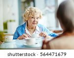 mature woman talking to her... | Shutterstock . vector #564471679