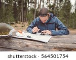 man on the nature with a phone... | Shutterstock . vector #564501754