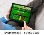 man using sports betting app | Shutterstock . vector #564513109