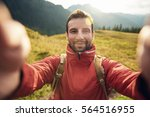 man in hiking gear taking a... | Shutterstock . vector #564516955