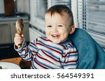 child holding a chicken and... | Shutterstock . vector #564549391