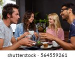 smiling friends enjoying coffee ... | Shutterstock . vector #564559261