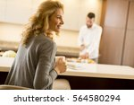 young couple preparing meal in... | Shutterstock . vector #564580294