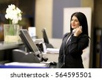 Stock photo hotel receptionist modern luxury hotel reception counter desk with bell happy female receptionist 564595501