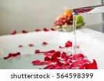 rose petals put in bathtub for... | Shutterstock . vector #564598399