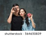 young asian couple enjoy eating ... | Shutterstock . vector #564650839