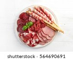 cold smoked meat plate with... | Shutterstock . vector #564690691
