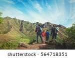 family with three kids hiking... | Shutterstock . vector #564718351