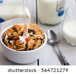 pouring milk into a bowl with... | Shutterstock . vector #564721279