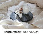 morning coffee and milk in bed | Shutterstock . vector #564730024