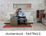young couple at home with ... | Shutterstock . vector #56478613