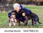 Stock photo beautiful mature woman walking dogs in the countryside 564788131
