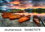 An Oil Painting Of Boats On Th...