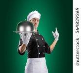 cook with restaurant cloche... | Shutterstock . vector #564829369