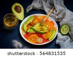 salad of citrus and avocado | Shutterstock . vector #564831535