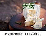 blue cheese on the old wooden...